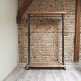 Modern wooden rack in the loft interior Stock Photo