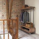 Modern wooden rack in the loft interior Stock Image