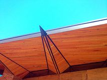 Modern wooden roof structure. On a new building stock photo