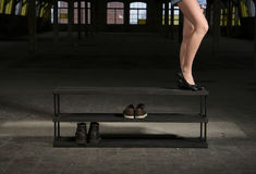 Modern wooden shoe rack in the loft interior Stock Photography