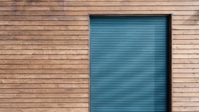 Modern wooden siding with aluminum shutters Royalty Free Stock Images