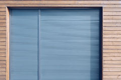 Modern wooden siding with aluminum shutters Royalty Free Stock Photography