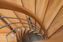 Modern wooden spiral stairs. Retail of modern wooden spiral stairs Royalty Free Stock Photos