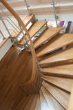 Modern wooden spiral stairs Stock Images