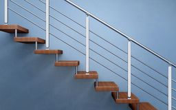 Modern wooden staircase with chromed railing Stock Photos