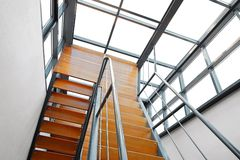 Modern Wooden Staircase. Downward View of a Wooden U-Shaped Modern Staircase royalty free stock photography