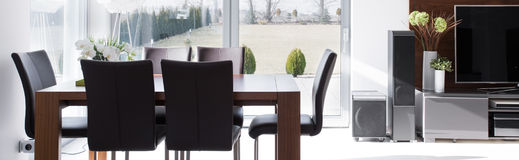 Modern wooden table and chairs Stock Image