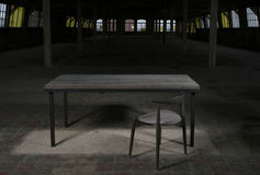 Modern wooden table in the loft interior Royalty Free Stock Image
