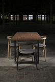 Modern wooden table in the loft interior Royalty Free Stock Photography