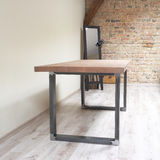 Modern wooden table in the loft interior Royalty Free Stock Photo