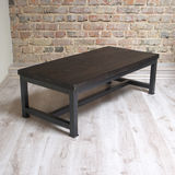 Modern wooden table in the loft interior Stock Images