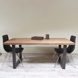 Modern wooden table in the loft interior Stock Photo