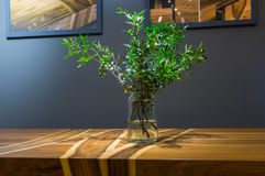 Modern wooden table made of different kinds of wood with a vase Royalty Free Stock Photos