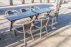 Modern wooden tables and chairs with metal frame of restaurant Stock Photo