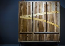 Modern wooden wardrobe made of different kinds of wood using var Stock Photo