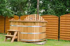 Modern wooden water hot tub with stairs outdoor Stock Photography