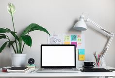 Modern work table with blank computer laptop and accessories in home office studio.Freelance designer or blogger concepts ideas royalty free stock photos