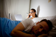 Modern Workaholic Couple Royalty Free Stock Photos
