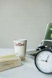 Modern working desk with laptop coffee and alarm clock Royalty Free Stock Photography