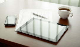 Modern workplace with Apple iPad and iPhone stock photo