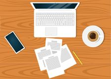 Modern workplace on on beautiful wooden table surface, top view. Laptop, documents, pencil, smartphone, cup of coffee. Modern workplace on on beautiful wooden Stock Image