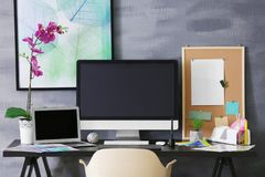 Modern workplace of designer with devices. Modern workplace of designer with modern devices royalty free stock photos
