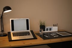 Modern workplace interior with laptop and devices on table. Space for text royalty free stock photos