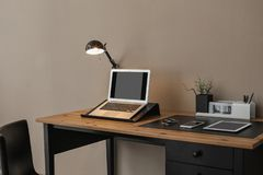 Modern workplace interior with laptop and devices on table. Space for text royalty free stock photo