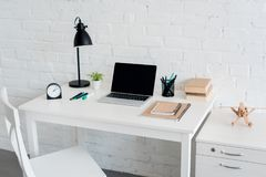 modern workplace with laptop at home in front of white royalty free stock image