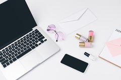 Modern workplace with laptop. Modern girly workplace with laptop and smartphone Royalty Free Stock Image