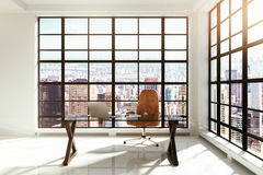 Modern workplace in a loft interior Stock Photos