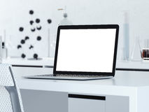 Modern workplace with opened laptop . 3d rendering Royalty Free Stock Image