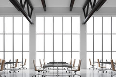 Modern workplaces in a modern bright clean interior of a loft style office. Huge windows with copy space and white walls. Black de Royalty Free Stock Images