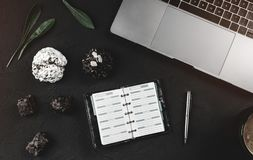 Modern workspace for a businessman, laptop and work notepad, sweets with chocolate and coffee Royalty Free Stock Images