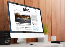 Modern workspace with computer showing news website Stock Photo