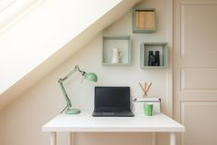 Modern workspace interior in cozy attic / loft apartment. stock photography