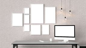 Modern workspace with isolated empty frames on brick wall and is. Olated computer screen. 3D illustrating Royalty Free Stock Image