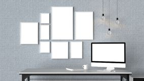 Modern workspace with isolated empty frames on brick wall and is Stock Photo