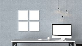 Modern workspace with isolated empty frames on brick wall and is Royalty Free Stock Photography