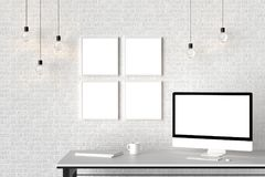 Modern workspace with isolated empty frames on brick wall and is Royalty Free Stock Photos