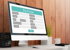 Modern workspace with petition Form. Modern wooden workspace with Stock Photography