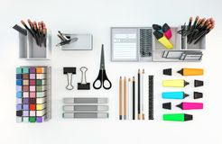 Modern workspace with stationery set on white color background. Top view. Flat lay. 3D illustration. Modern workspace with stationery set on white color Royalty Free Stock Photography