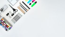 Modern workspace with stationery set on white color background. Top view. Flat lay. 3D illustration. Modern workspace with stationery set on white color Stock Image