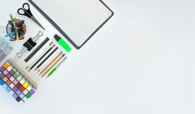 Modern workspace with stationery set on white color background. Top view. Flat lay. 3D illustration. Modern workspace with stationery set on white color Stock Photo