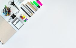 Modern workspace with stationery set on white color background. Top view. Flat lay. 3D illustration. Modern workspace with stationery set on white color Stock Photos