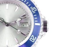 Modern wristwatch. Blue wristwatch detail on white background Stock Images