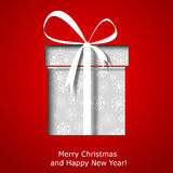 Modern Xmas greeting card with Christmas gift box Royalty Free Stock Photos