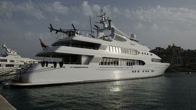 The modern yacht with helicopter on top stock video footage