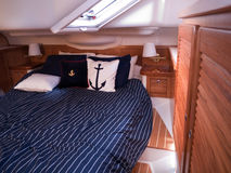 Modern yacht interior. Mahogany furniture and finish in the bedroom Stock Photo