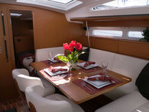 Modern yacht interior. Mahogany furniture and finish in the dining room Stock Image